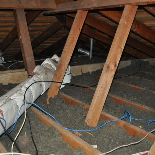 Attic insulation is weak and needs more to increase comfort level in home