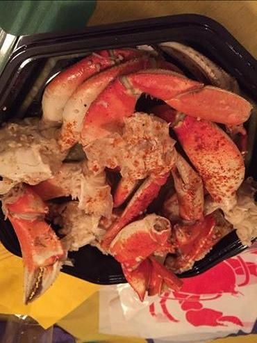 Hot Garlic Crab - Fresh Dungeness Crab Prepared with Creole Seasoning and topped with /Hot Garlic Butter and a Little Cayenne Red Pepper on Top