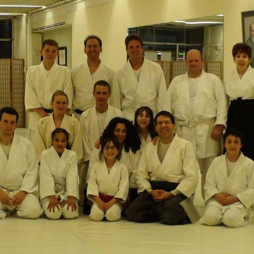 Family Martial Arts + Adults Martial Arts Program - Adults Grappling Arts Program - Parents include their children in the Family class.