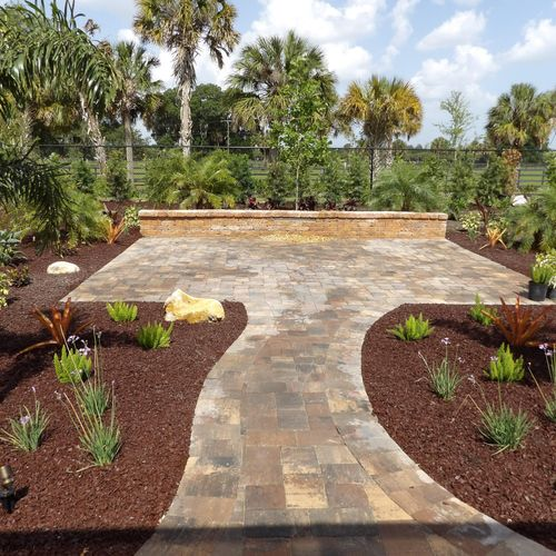 Paver patio with walkways and waterfall wall.