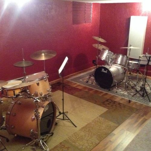 Two drum sets are provided to help students to learn to play by ear