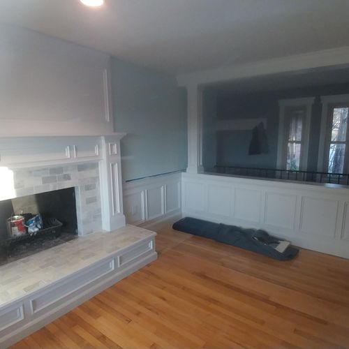 """Custom Mantle & Hearth, Custom 8"""" pillars to match design connected with wainscotting"""
