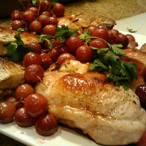 Fontina and Prosciutto Stuffed Pork Chops and Grapes