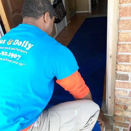 Laying runners and floor protectors is a part of what we do to protect your floors!