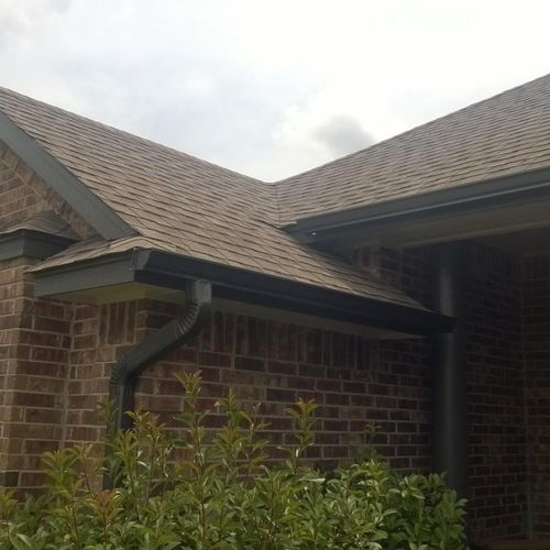 Overlapping eaves with downspout