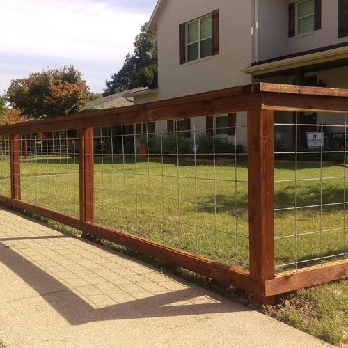 Modern Ranch Style fence with Hog Wire and stained ReadySeal Dark Walnut color
