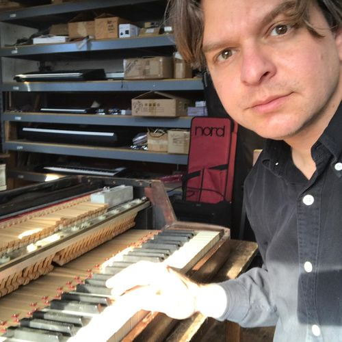 Hard at work on a 1950's wurlitzer electric piano