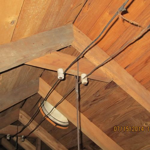 Old knob and tube wiring in attic.