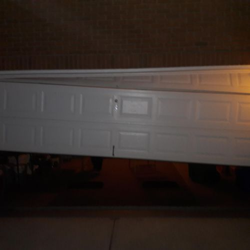 This is an example of your doors off track! Yikes!