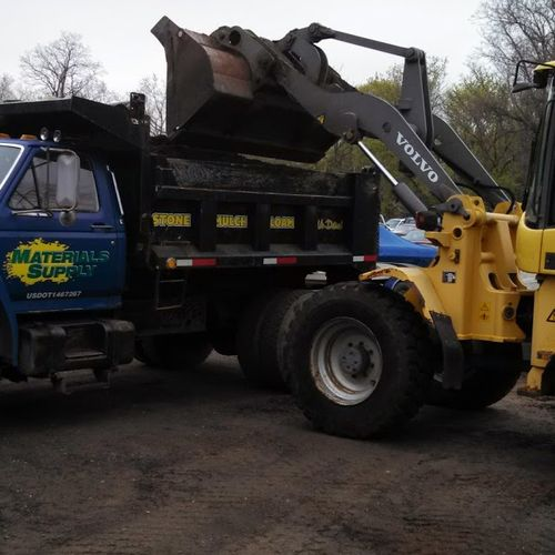 Volvo Loader loading Small Dump