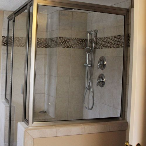Completed shower with bench, hand held and rain head nozzles