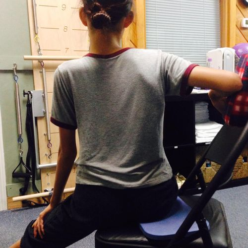Working with a teen who has Scoliosis.