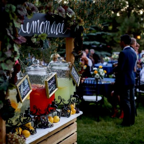 Dressing up drink station with an outdoor lemonaid stand.