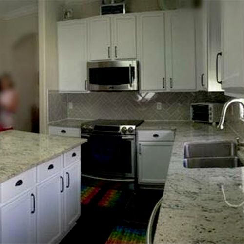White Colonial granite countertops in kitchen.