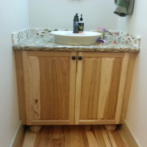 Hickory cabinet in 1/2 bath with granite top