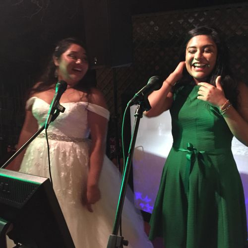 Bride and sister singing some karaoke.