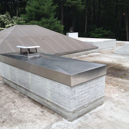 Custom chase cover installed with flue cap