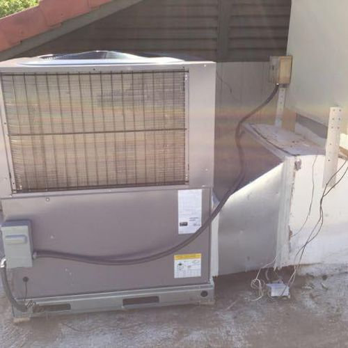 BRYANT Side/Side packaged heat pump with twist transition to downflow piggy-back cooler AFTER