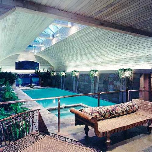Indoor Pool ..... China Lotus slate with bush hammered granite pyramid columns and soffit lighting give a grand statement to the space.