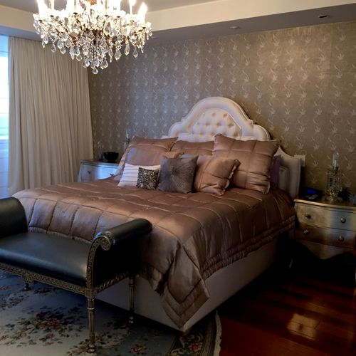 Euro-chic bedroom (Philip Jeffries wallcovering, custom upholstered bed, custom finished nightstands, Crystal chandelier.