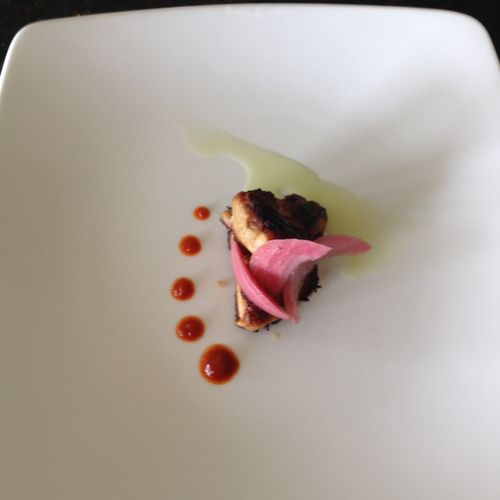 sou- vide pork  belly, fried, with ponzu and jalepeno jelly and a red pepper coulis, with pickled red onion garnish