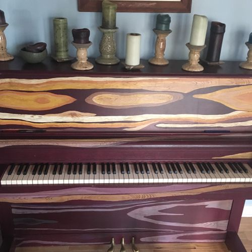 Beautiful hand painted piano at the NMA studio. Each studio room is unique and eclectic.