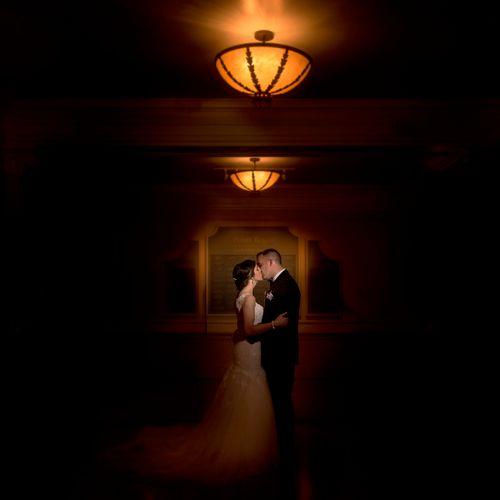 Wedding couple in dark hallway