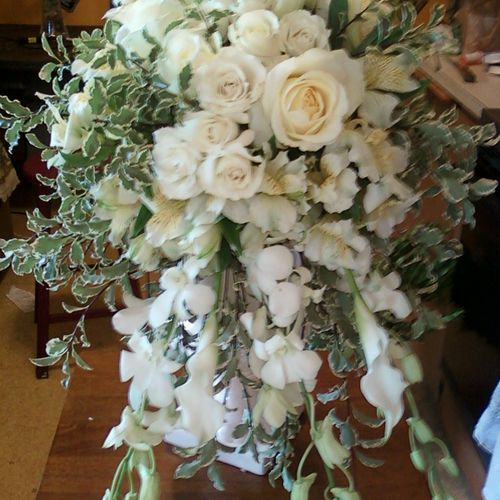 Orchids , roses & callas cascading