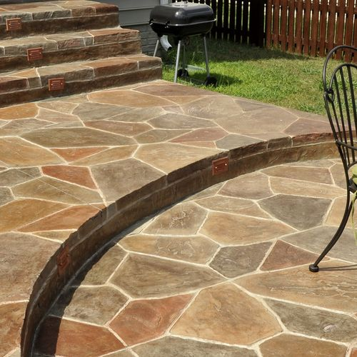 This is a very unique variation of our multi-color, grouted stamped concrete.