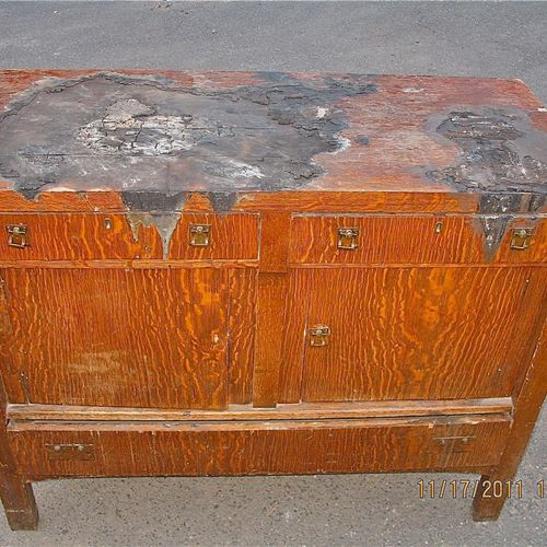 Before - Cabinet damaged by fire
