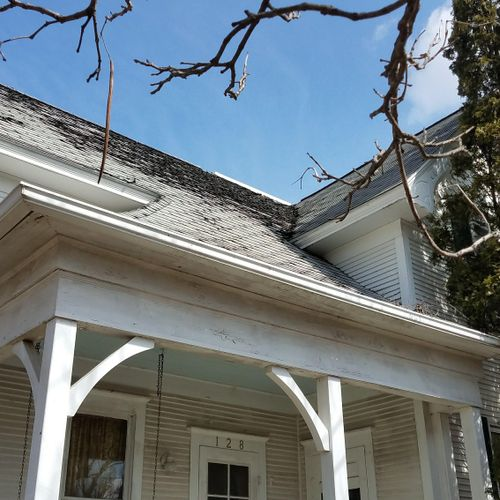One of the original houses in Swisher: south-facing elevation, before, organic three-tab Certainteed, 15 years old
