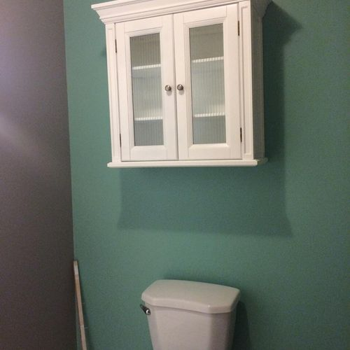 Bathroom remodel Painting and Carpentry. Customer wanted a cabinet refinished and mounted.
