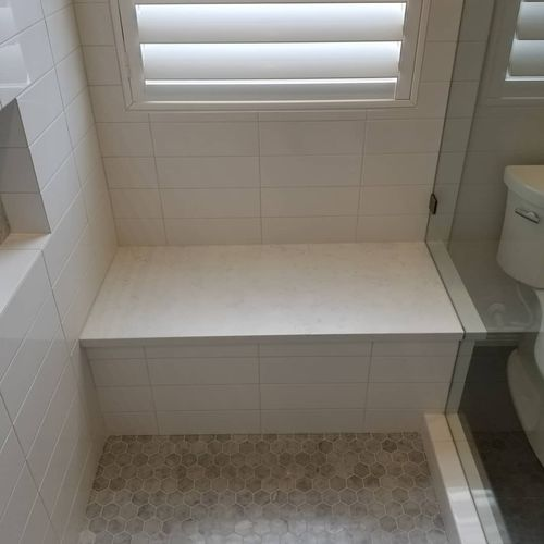 Quartz bench top, mitered corners on tile
