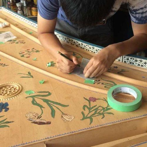 Decorating a harpsichord soundboard
