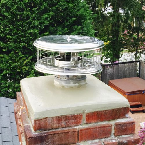 DNG cleaned, and repaired this chimney, and installed a round chimney cap to prevent moisture and animals from getting into the chimney.