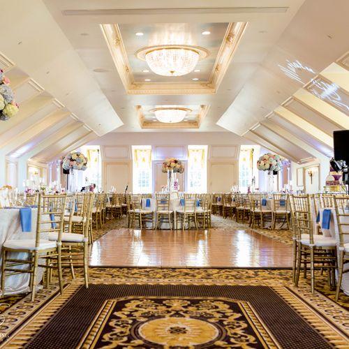 Banquet Hall uplighting, monogram, and cake highlighting service. Photography courtesy of oneelevenweddings.com