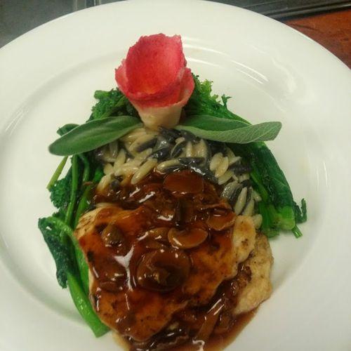 Chicken with mushroom gravy. Tuxedo orzo risotto and broccoli rabe.