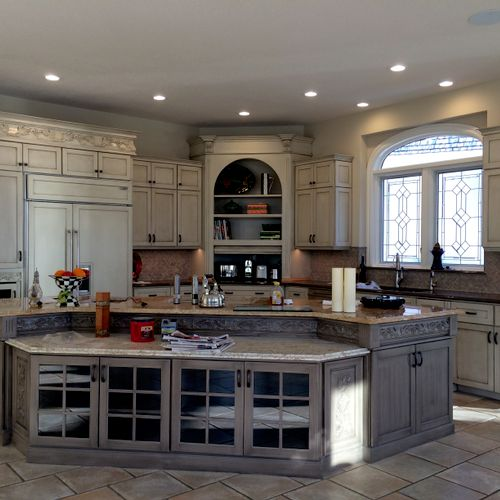 Custom painting and decorative finish on cabinets and island