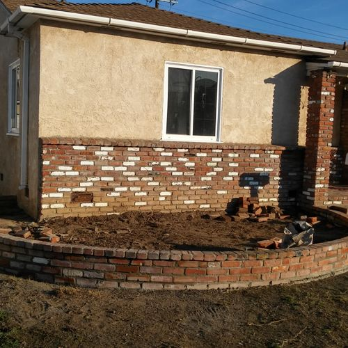 After Repairs made to planter wall.
