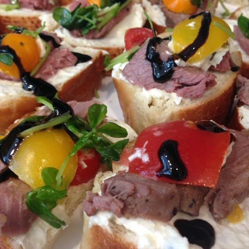 Tri Tip Sliders Open Faced with Horseradish Cream, Tomato and Pea Shoots