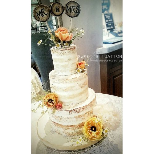 rustic naked cake with fresh flowers