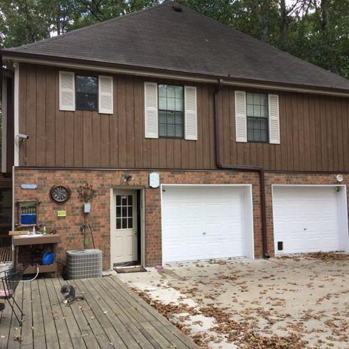 Exterior paint, flashing, garage door trim replacement, flashing and gutter repair
