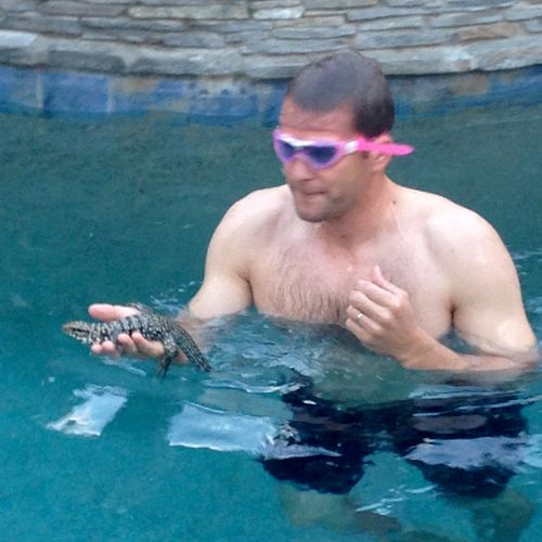 Here's Max catching a lizard in a customers pool, he goes above and beyond!