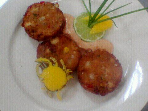 Roasted Corn Crab Cakes w/Roasted tomato Remoulade w/Lemon peel crab sculpture.