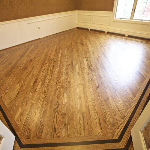 Finished diagonal installation with feature strip. Early American stain