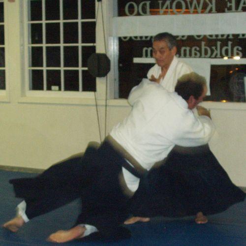 Kato Sensei (direct student of founder) throwing me.