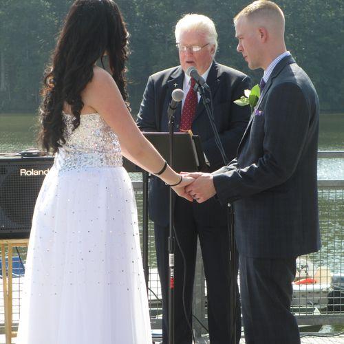 Rev Jim Officiating vow renewal ceremony on Lake Johnson, 2016