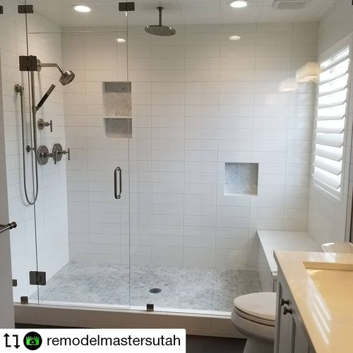 Tub and old shower demolition, to accommodate this beautiful steam shower with full glass