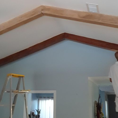 staining wood beams on the living room ceiling