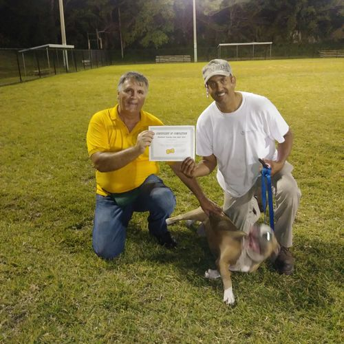Another proud owner with is dog after graduation received his certificate of completion.